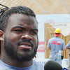 Globe/T. Rob Brown Kansas City Chiefs first-round draft pick Dontari Poe takes a break from work to talk to the media as other players and personnel help build one of several homes in association with Habitat for Humanity Friday afternoon, June 15, 2012, in the vicinity of Kentucky Avenue and 26th Street.
