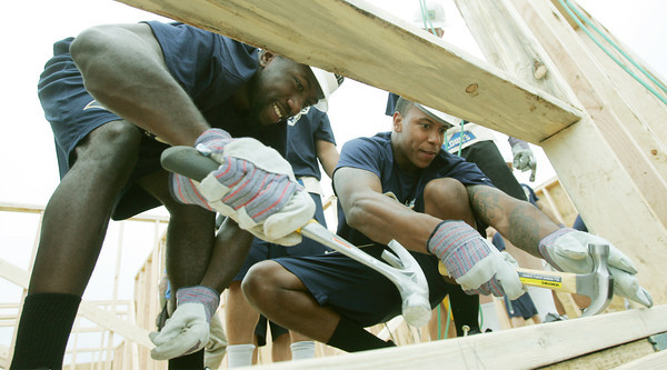 Globe/Roger Nomer<br /> St. Louis Rams rookies Brian Quick, left, and Trumaine Johnson hammer nails on a house at 2301 Kentucky on Thursday.