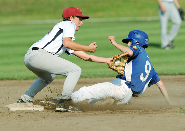 Globe/Roger Nomer<br /> Joplin's Millard unsuccessfully tries to tag Pryor's Casey Holloway on a steal attempt at second during Tuesday's game.