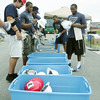 Globe/Roger Nomer<br /> Rookie football players from the St. Louis Rams pick up their equipment to work on three Habitat for Humanity projects on Thursday.