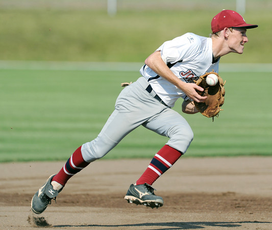 Globe/Roger Nomer<br /> Joplin's Bryce Ash flips a ball out of his glove as he prepares to throw to first base during Tuesday's game against Pryor.