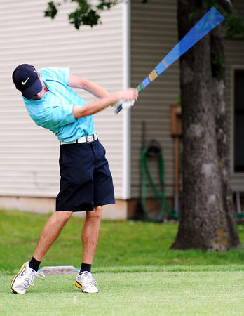 Globe/T. Rob Brown<br /> The force of his swing is strong during a sudden death playoff portion of Sunday's championship flight at Briarbrook Golf Course & Country Club in Carl Junction.
