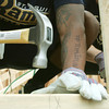"Globe/Roger Nomer<br /> St. Louis Rams rookie Trumaine Johnson works with the title ""Team Joplin"" on his arm on Thursday."