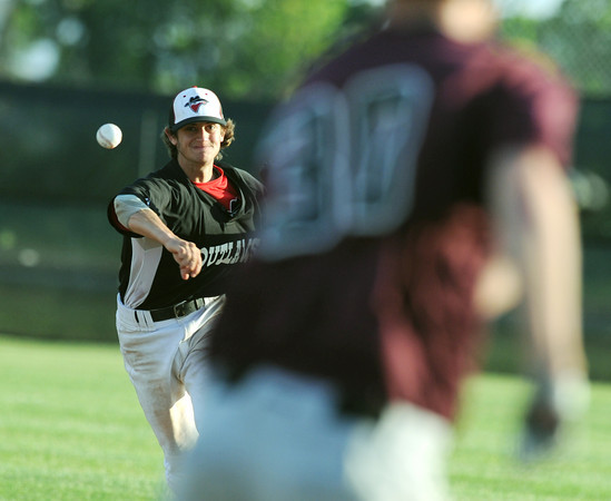 Globe/Roger Nomer<br /> Joplin's Jimmy Obermark throws out a Chillicot runner at first during Tuesday's game.