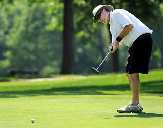 Globe/T. Rob Brown<br /> Lou Rapalino, of Parsons, Kan., watches the start of a long putt Saturday afternoon, June 9, 2012, at Briarbrook Golf Course and Country Club. The attempt was close.