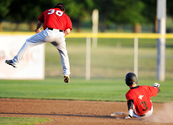Globe/T. Rob Brown<br /> Joplin Outlaws runner Justin Treece steals second as St. Joseph's #36 brings down a high throw Tuesday evening, June 5, 2012, at the newly-named Wendell Redden Field