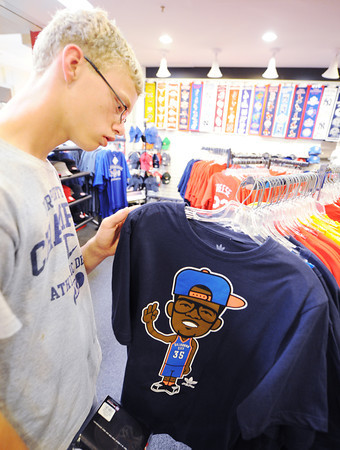 Globe/T. Rob Brown Kyle Tastad, 16, of South Dakota, who is in Joplin on a mission trip to help Joplin rebuild, looks at an Oklahoma City Thunder T-shirt of #35 Durant, his favorite player, for sale at TNT Sports at Northpark Mall in Joplin. Tastad ended up purchasing the Durant T-shirt.