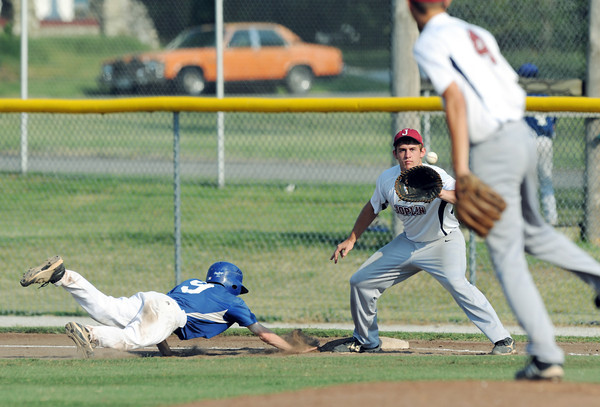 Globe/Roger Nomer<br /> Joplin's #4 (starting pitcher) throws a pick off attempt to Miller (#25) as Pryor's Casey Holloway scrambles back to first during Tuesday's game.