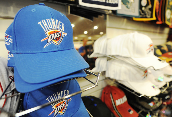 Globe/T. Rob Brown Oklahoma City Thunder hats are part of the merchandise for sale at TNT Sports at Northpark Mall in Joplin.