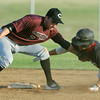 Globe/Roger Nomer<br /> Joplin's #29 is tagged out by Chillicothe's Ricky Martinez on a steal during Tuesday's game.