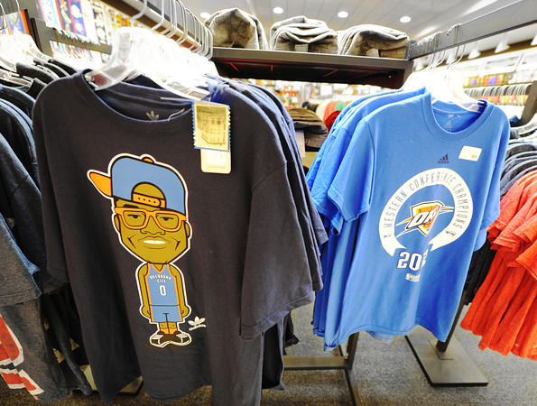 Globe/T. Rob Brown Oklahoma City Thunder T-shirts are part of the merchandise for sale at TNT Sports at Northpark Mall in Joplin. Player #0 Westbrook is featured on the T-shirt at left.