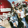 Globe/Roger Nomer<br /> Joplin High football players break practice during Joplin High's summer football camp on Wednesday.