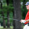 Globe/T. Rob Brown<br /> watches a hit from the fairway during sudden death playoff portion of Sunday's championship flight at Briarbrook Golf Course & Country Club in Carl Junction.