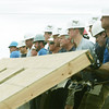 Globe/Roger Nomer<br /> Staff from the St. Louis Rams and Habitat for Humanity raise a wall on a house at 2301 Kentucky on Thursday afternoon.
