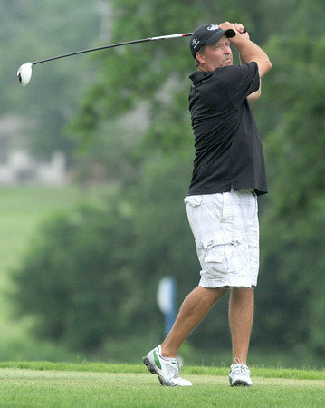 Steve Hoenshell watches his drive off the no. 2 tee during the first day of action on Friday at the Briarbrook Invitational in Carl Junction.<br /> Globe | Laurie Sisk