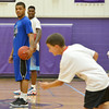 Globe/Roger Nomer<br /> Kansas University's Frank Mason, left, and Jamari Traylor watch campers run drills during the Collegiate All-Stars Basketball Camp at Pittsburg High School on Monday.