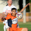Demize forward Luis Cadena battles Liverpool's xxx xxx (5) for the ball during their match on Friday night at the Joplin Athletic Complex.<br /> Globe Laurie Sisk