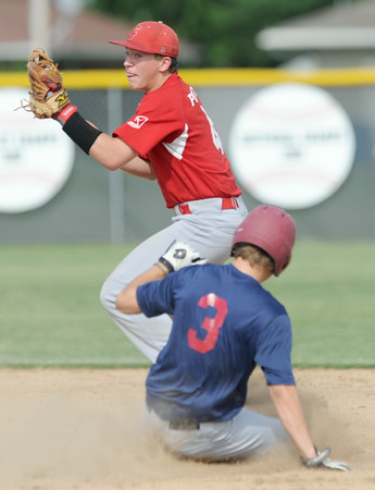 Carl Junction's Ben Luter gets Joplin's Chris Leonardi on a force play at second during both teams' American Legion opener on Tuesday at Carl Junction.<br /> Globe | Laurie Sisk