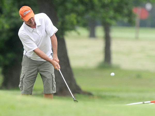 Scott Hartley chips the ball onto the no. 1 green during the first day of action on Friday at the Briarbrook Invitational in Carl Junction.<br /> Globe | Laurie Sisk