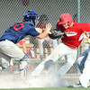 Joplin catcher Tyson Hardee tags webb City's Kolesen Crane during a run down between thrid and home during their game on Thursday night at Wendall Redden Field. Also picture is Joplin's Tristan Ash, right.<br /> Globe   Laurie Sisk