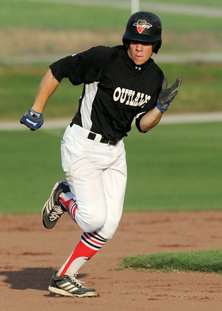 Outlaws infielder Zak Himes rounds second base for a triple off a long fly ball during Joplin's game against the Branson Nationals on Tuesday night at Joe Becker Stadium. Himes scored later in the inning.<br /> Globe | Laurie Sisk