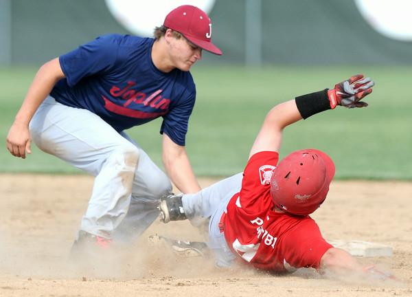 Joplin's Chris Leonardi tags Carl Junction's Ben Luter on a stolen base attempt at second during both teams' American Legion opener on Tuesday at Carl Junction.<br /> Globe | Laurie Sisk