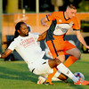 Liverpool's xxx, left gets tagged with a yellow card as he and Demize forward Jordan Aidoud battle during their match on Friday night at the Joplin Athletic Complex.<br /> Globe Laurie Sisk