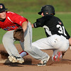Outlaw outfielder Kadin Hydrick safely steals second base as Branson Nationals second baseman xxx xxxx (2) fields the ball during their game on Tuesday night at Joe Becker Stadium.<br /> Globe | Laurie Sisk