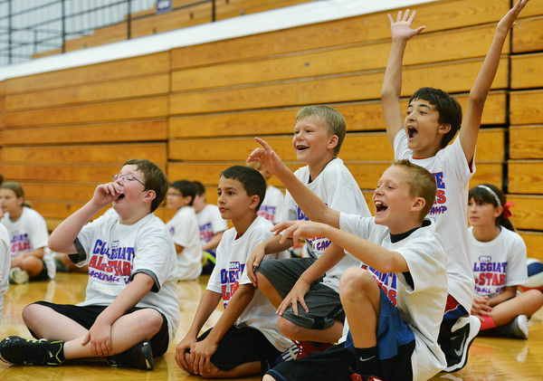 Globe/Roger Nomer<br /> Campers at the Collegiate All-Stars Basketball Camp cheer a shot by Kansas University's Frank Mason during a one-on-one drill at Pittsburg High School on Monday.