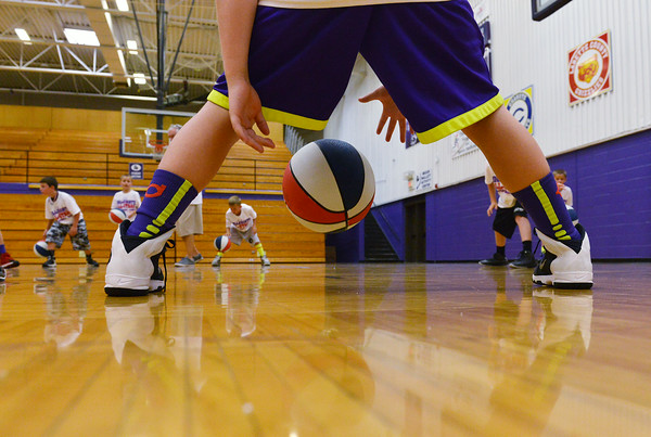 Globe/Roger Nomer<br /> Grant Roelfs, 10, practices dribbling between his legs during the Collegiate All-Stars Basketball Camp at Pittsburg High School on Monday.
