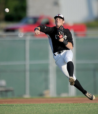 Outlaws shortstop John Fleek throws a runner out during Joplin's game against the Ozark Generals on Wednesday night at Wendell Redden Field.<br /> Globe | Laurie Sisk