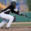 Outlaws speedster Brandon Pugh tries to bunt his way on base during Joplin's game against the Ozark Generals on Wednesday night at Wendell Redden Field.<br /> Globe | Laurie Sisk