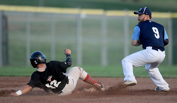Outlaws catcher Mason Brown tries to break up a double play as Ozark's Rob Ruzicka prepares to throw during their game on Wednesday night at Wendell Redden Field.<br /> Globe | Laurie Sisk