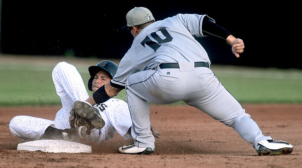 Blasters centerfielder Oscar Mesa slides safely into second base as Laredo's J.D. Pulfer applies the tag  during their game on Tuesday night at Joe Becker Stadium.<br /> Globe | Laurie Sisk
