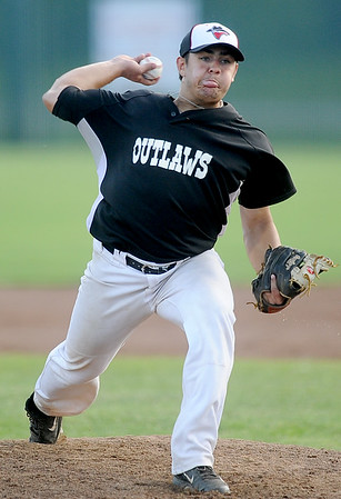 Outlaws starter J.C. Hatcher throws from the mound during Joplin's game against the Ozark Generals on Wednesday night at Wendell Redden Field.<br /> Globe | Laurie Sisk