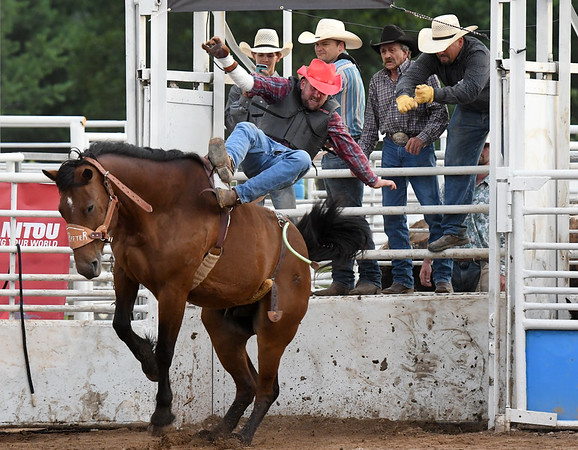 Galena cowboy Scotty Allumbaugh gets bucked off out of the chute on Saturday night at the 42nd Annual Carthage Stampede Rodeo at the Carthage Saddle Club Arena.<br /> Globe | Laurie Sisk