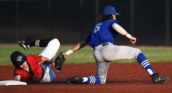 Joplin's David Butterfield gets tagged out by Nevada's Ben Palinski after an attempted steal during their game on Friday night at Joe Becker Stadium.<br /> Globe | Laurie SIsk