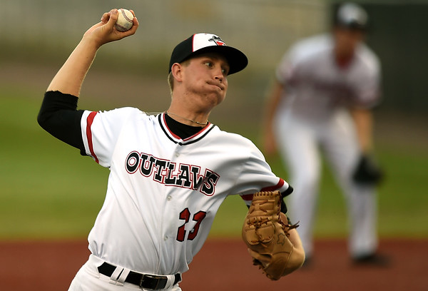 Joplin starter Malachi Crone delivers a pitch to the plate during the Outlaws game against the Chillicothe Mudcats on Tuesday night at Joe Becker Stadium.<br /> Globe | Laurie Sisk
