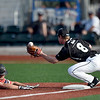 Joplin's Zack Ehlen slides safely into third base as Sedalia's Quin Reasoner tries to field the throw during their gme on Saturday night at Joe Becker Stadium. Ehlenn scored on the error.<br /> Globe | Laurie Sisk