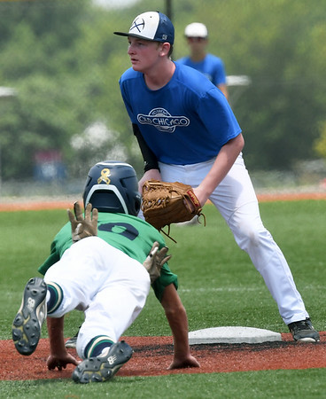Oklahoma City's xx (10) slides safely into second base as Southwest Missouri All-Star XX (10) awaits the throw during their game on Saturday at Joplin High School.<br /> Globe | Laurie SIsk