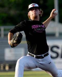 Joplin's Austin Neal delivers a pitch to the plate during the Outlaws game against Clarinda on Friday night at Joe Becker Stadium. Globe | Laurie SIsk