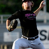 Joplin's Austin Neal delivers a pitch to the plate during the Outlaws game against Clarinda on Friday night at Joe Becker Stadium.<br /> Globe | Laurie SIsk