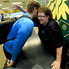 """Missouri Southern football player Aiden Brown, left, gets his daily hug from Denise Terry, affectionately known as """"Momma D"""" to Missouri Southern students as she stands near her cashiers station in the Mayse Dining Hall on Wednesday. terry was recently honored by the MIAA for her service to student athletesT<br /> Gkobe 