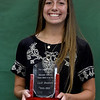 Nevada's Calli Beshore holds her Wendell Redden Female Athlete of the Year award at the conclusion of The Joplin Globe Athletes of the Year banquet on Tuesday night at Missouri Southern. Beshore excelled at track, basketball and cross country at Nevada.<br /> Globe | Laurie SIsk