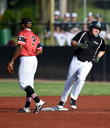 Sedalia's Kyle Clayton rounds the bases after a two run home run during the Bombers game against Joplin on Saturday at Joe Becker Stadium. Also pictured in Outlaws shortstop Freilin Cabrera (9.)<br /> Globe | Laurie Sisk
