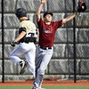 Neosho's Wyatt Keplar beats the throw to first base as Joplin's XX XX (21) gloves the ball during their game on Tuesday night at Joplin High School.<br /> Globe | Laurie Sisk