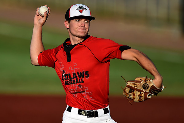 Outlaws starter Hunter Hatfield delivers a pitch to the plate during Joplin's game against the Nevada Griffins on Friday night at Joe Becker Stadium.<br /> Globe | Laurie SIsk