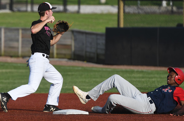 Outlaws shortstop David Butterfield gets the force out on Clarinda's XX XX (15) during their game on Friday night at Joe Becker Stadium.<br /> Globe | Laurie Sisk