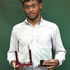 Joplin's Zach Westmoreland holds his Football Player of the Year award and his Wendell Redden Male Athlete of the Year award at the conclusion of The Joplin Globe Athletes of the Year banquet on Tuesday night at Missouri Southern. Westmoreland excelled at track, basketball and football for the Eagles.<br /> Globe | Laurie SIsk