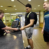 """From the left: Denise Terry, affectionately known as """"Momma D"""" to Missouri Southern students, visits with MSSU football players Dylan Wright and Gibson Beyer in the Mayse Dining Hall on Wednesday. Terry was recently honored by the MIAA for her service to student athletes. <br /> Gkobe 